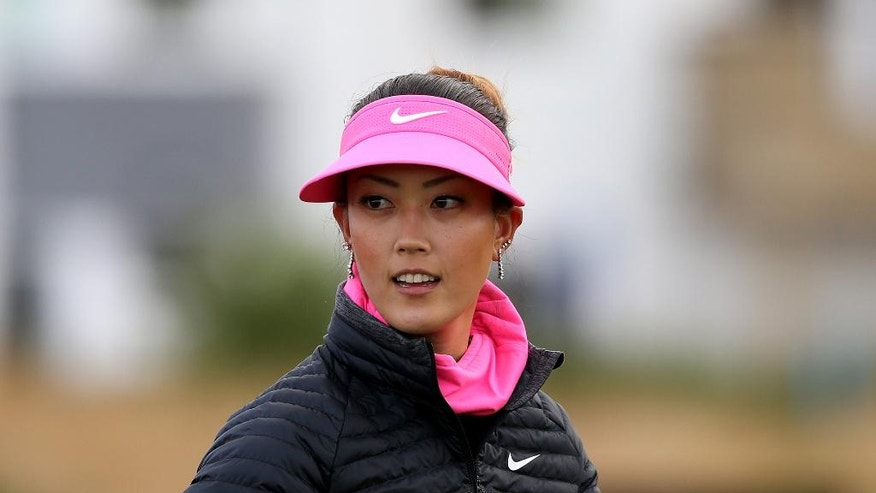 Michelle Wie of the U.S. walks from the first tee during the first day of the Women's British Open golf championship on the Turnberry golf course in Turnberry, Scotland, Thursday, July 30, 2015. (AP Photo/Scott Heppell)