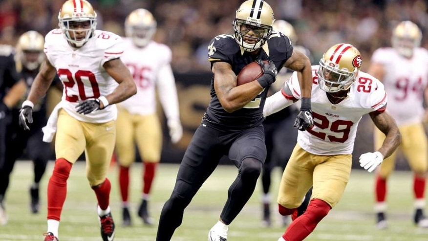 Nov 9, 2014; New Orleans, LA, USA; New Orleans Saints wide receiver Marques Colston (12) carries the ball as San Francisco 49ers cornerbacks Perrish Cox (20) and Chris Culliver (29) chase in the fourth quarter at Mercedes-Benz Superdome. The 49ers won 27-24. Mandatory Credit: Chuck Cook-USA TODAY Sports