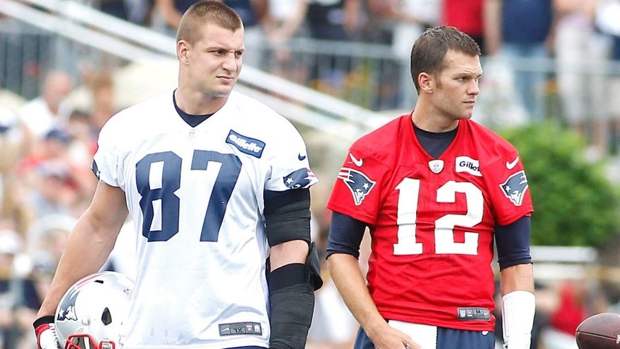 Jul 24, 2014; Foxborough, MA, USA; New England Patriots tight end Rob Gronkowski (87) and quarterback Tom Brady (12) during training camp at the team practice facility. Mandatory Credit: Stew Milne-USA TODAY Sports