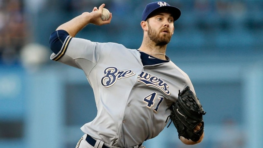 <p>Milwaukee Brewers starting pitcher Taylor Jungmann delivers against the Los Angeles Dodgers during the first inning of a baseball game, Saturday, July 11, 2015, in Los Angeles. (AP Photo/Danny Moloshok)</p>