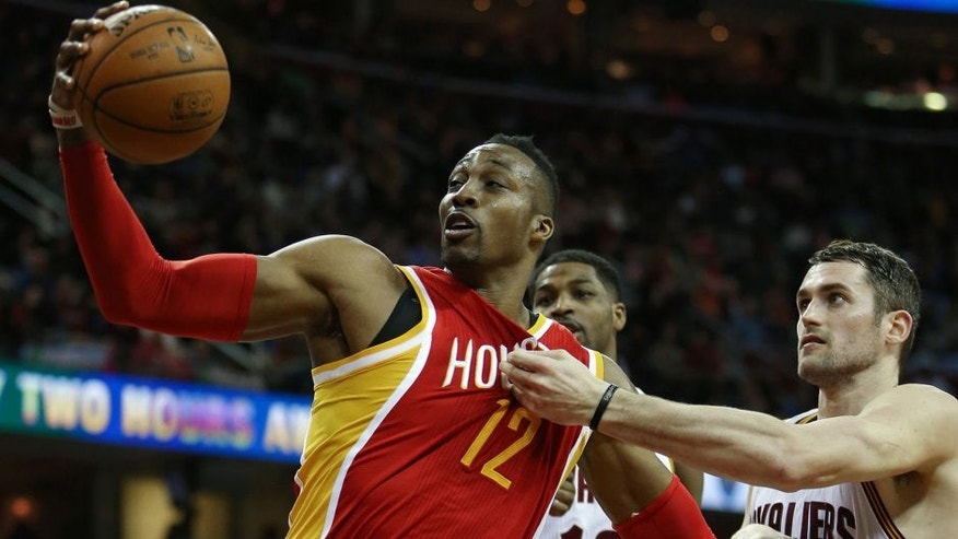 <p>Jan 7, 2015; Cleveland, OH, USA; Houston Rockets center Dwight Howard (12) grabs a rebound against Cleveland Cavaliers forward Kevin Love (0) and forward Tristan Thompson (13) during the second quarter at Quicken Loans Arena. Mandatory Credit: <br> </p>
