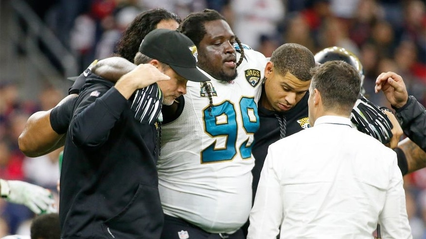 Dec 28, 2014; Houston, TX, USA; Jacksonville Jaguars defensive tackle Sen'Derrick Marks (99) is injured during the first half against the Houston Texans at NRG Stadium. Mandatory Credit: Kevin Jairaj-USA TODAY Sports