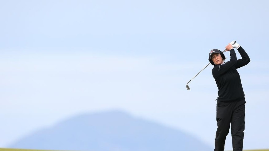 Cristie Kerr of the U.S plays her second shot on the 9th fairway during the second day of the Women's British Open golf championship on the Turnberry golf course in Turnberry, Scotland, Friday, July 31, 2015. The island of Ailsa Craig is seen in the background.  (AP Photo/Scott Heppell)