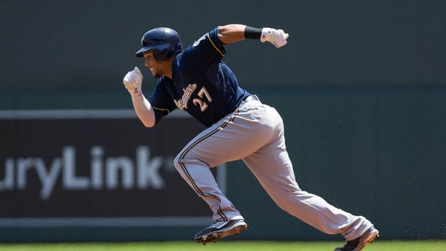 <p>Jun 6, 2015; Minneapolis, MN, USA; Milwaukee Brewers center fielder Carlos Gomez (27) steals in the first inning against the Minnesota Twins at Target Field. Mandatory Credit: Brad Rempel-USA TODAY Sports</p>