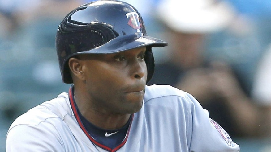 <p>Minnesota Twins' Torii Hunter bunts for a single in the first inning of a baseball game against the Texas Rangers, Friday, June 12, 2015, in Arlington, Texas. (AP Photo/Ron Jenkins)</p>
