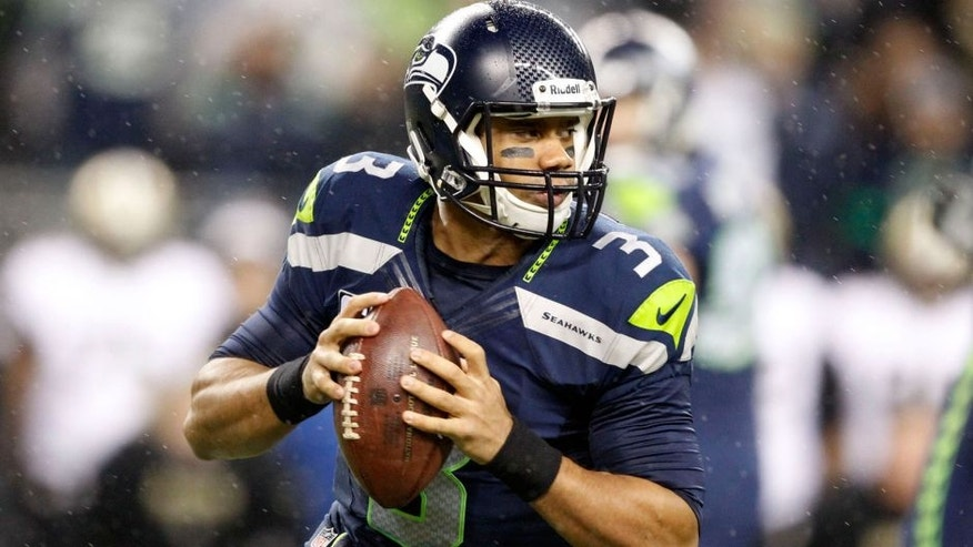 <p>Dec 2, 2013; Seattle, WA, USA; Seattle Seahawks quarterback Russell Wilson (3) looks to pass against the New Orleans Saints during the first quarter at CenturyLink Field. Mandatory Credit: Joe Nicholson-USA TODAY Sports</p>