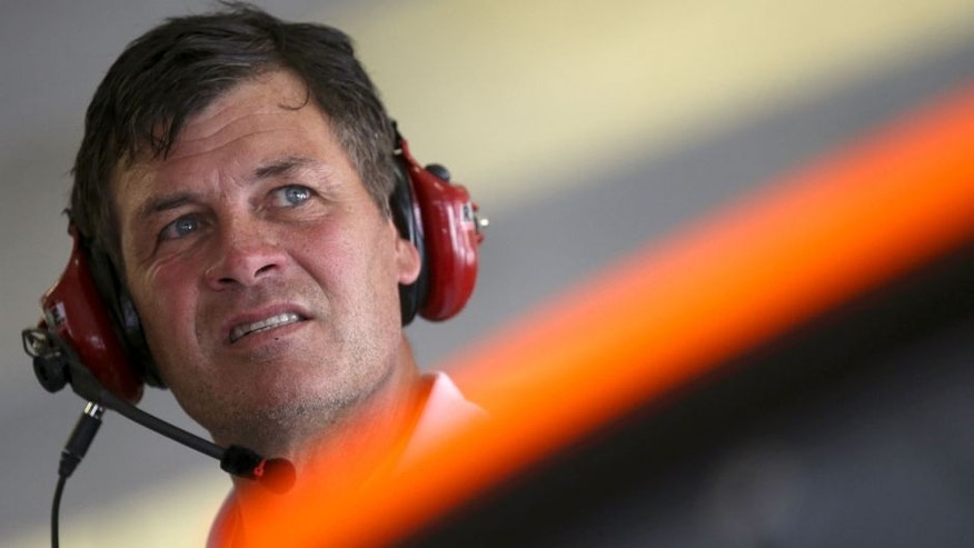 <p>Team owner Michael Waltrip stands in the garage area during practice for the NASCAR Sprint Cup Series Oral-B USA 500 at Atlanta Motor Speedway on August 30, 2014 in Hampton, Georgia.</p>