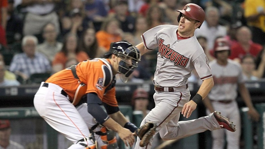 Jul 31, 2015; Houston, TX, USA; Arizona Diamondbacks shortstop Cliff Pennington (4) scores infront of Houston Astros catcher Jason Castro (15) in the seventh inning at Minute Maid Park. Mandatory Credit: Thomas B. Shea-USA TODAY Sports
