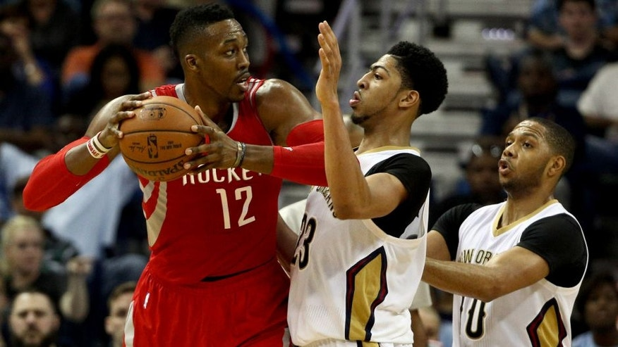 Mar 25, 2015; New Orleans, LA, USA; Houston Rockets center Dwight Howard (12) is defended by New Orleans Pelicans forward Anthony Davis (23) during the second half of a game at the Smoothie King Center. The Rockets defeated the Pelicans 95-93. Mandatory Credit: Derick E. Hingle-USA TODAY Sports
