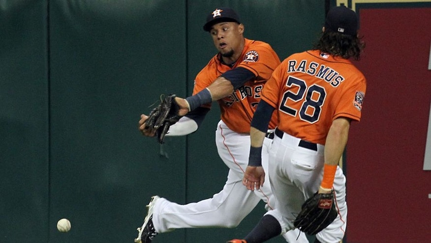 Jul 31, 2015; Houston, TX, USA; Houston Astros center fielder Carlos Gomez collides with left fielder Colby Rasmus (28) while chasing down Arizona Diamondbacks catcher Welington Castillo (not pictured) double in the sixth inning at Minute Maid Park. Mandatory Credit: Thomas B. Shea-USA TODAY Sports
