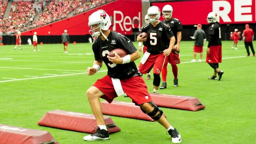 Aug 1, 2015; Glendale, AZ, USA; Arizona Cardinals quarterback Carson Palmer (3) does drills during training camp at University of Phoenix. Mandatory Credit: Matt Kartozian-USA TODAY Sports