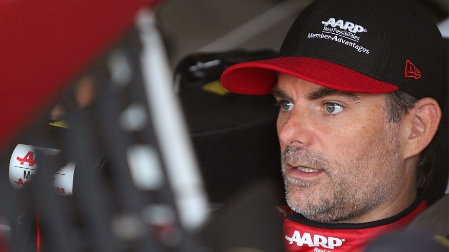 LONG POND, PA - AUGUST 01: Jeff Gordon, driver of the #24 AARP Member Advantages Chevrolet, sits in his car in the garage area during practice for the NASCAR Sprint Cup Series Windows 10 400 at Pocono Raceway on August 1, 2015 in Long Pond, Pennsylvania. (Photo by Jerry Markland/Getty Images)