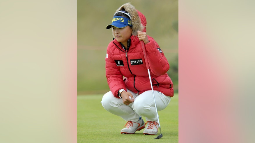 Jin-Young Ko of South Korea lines up her putt on the 2nd green during the third day of the Women's British Open golf championship on the Turnberry golf course in Turnberry, Scotland, Saturday Aug. 1, 2015. (AP Photo/Scott Heppell)