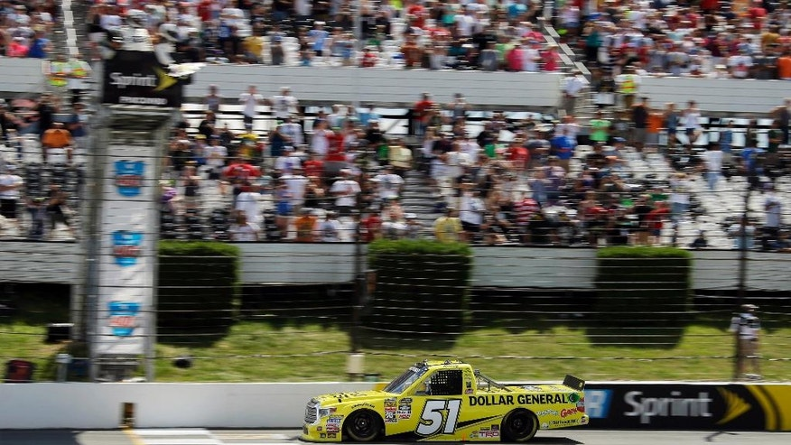 Kyle Busch crosses the finish line to win the NASCAR truck series Pocono Mountains 150 auto race, Saturday, Aug. 1, 2015, in Long Pond, Pa. (AP Photo/Matt Slocum)