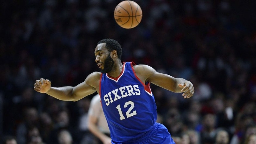 <p>Jan 3, 2015; Los Angeles, CA, USA; Philadelphia 76ers forward Luc Mbah A Moute (12) is unable to handle a pass against the Los Angeles Clippers during the second quarter at Staples Center. Mandatory Credit: <br> </p>