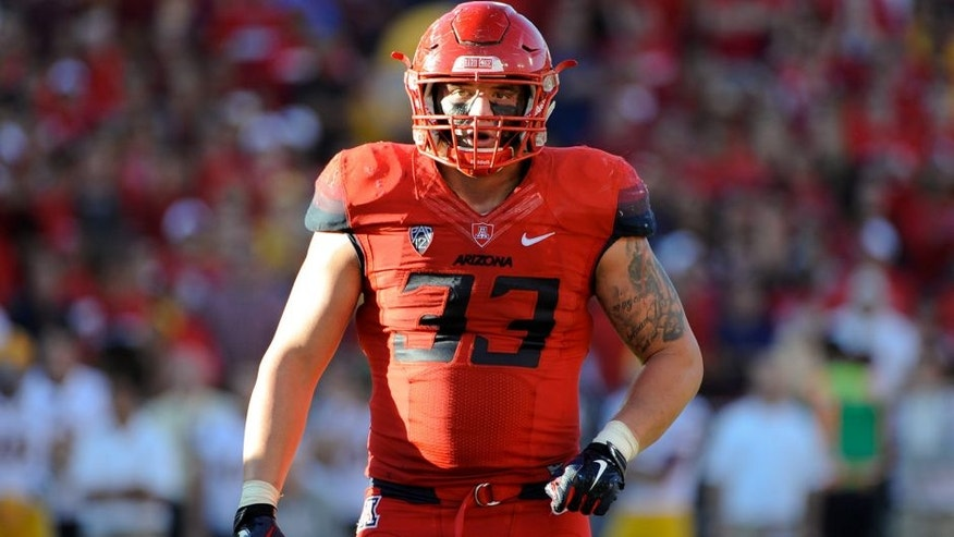 Nov 28, 2014; Tucson, AZ, USA; Arizona Wildcats linebacker Scooby Wright III (33) looks to the sideline during the third quarter of the territorial cup against the Arizona State Sun Devils at Arizona Stadium. The Wildcats won 42-35. Mandatory Credit: Casey Sapio-USA TODAY Sports