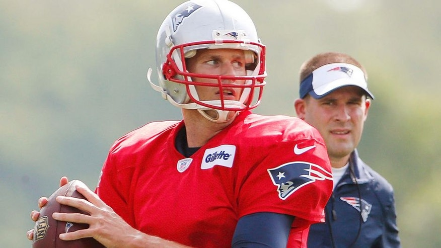 Jul 30, 2015; Foxborough, MA, USA; As offensive coordinator Josh McDaniels looks on, New England Patriots quarterback Tom Brady (12) throws during training camp at Gillette Stadium. Mandatory Credit: Winslow Townson-USA TODAY Sports