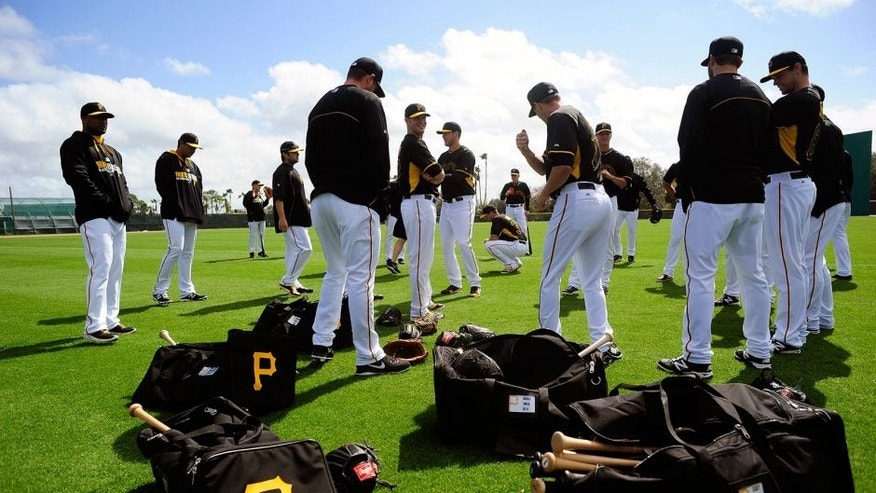 Feb 13, 2014; Bradenton, FL, USA; Pitchers stretch before the Pittsburgh Pirates' first spring training workout at Pirate City. Mandatory Credit: David Manning-USA TODAY Sports