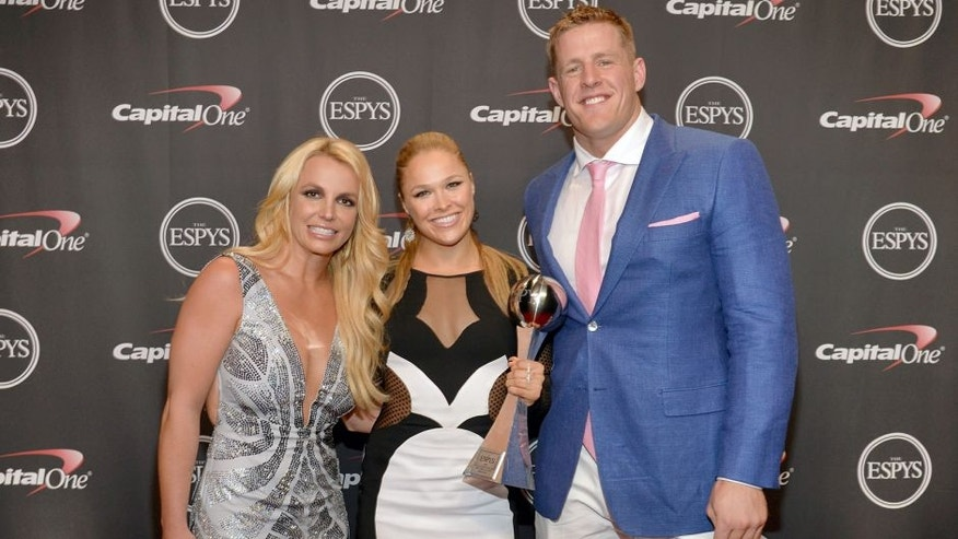 LOS ANGELES, CA - JULY 15: (L-R) Musician Britney Spears with MMA fighter Ronda Rousey and NFL player JJ Watt posing with award for Best Female Athlete at The 2015 ESPYS at Microsoft Theater on July 15, 2015 in Los Angeles, California. (Photo by Kevin Mazur/WireImage)