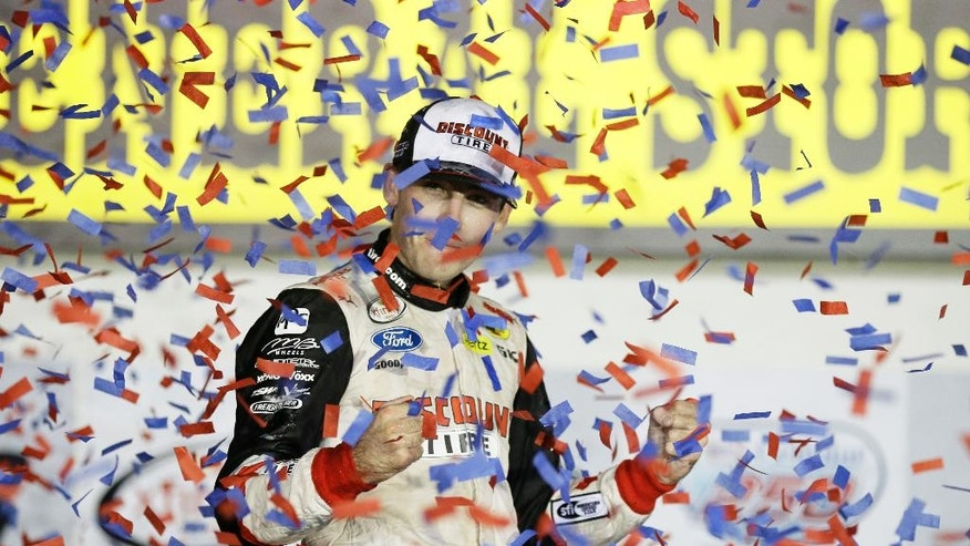 Ryan Blaney celebrates in Victory Lane after winning the NASCAR Xfinity Series auto race, Saturday, Aug. 1, 2015, at Iowa Speedway in Newton, Iowa. (AP Photo/Charlie Neibergall)