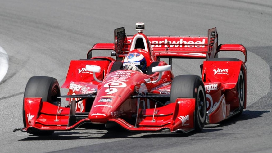 Scott Dixon, of New Zealand, on track during qualifying for the IndyCar Honda Indy 200 auto racing Saturday, Aug. 1, 2015, at Mid-Ohio Sports Car Course in Lexington, Ohio. (AP Photo/Tom E. Puskar)