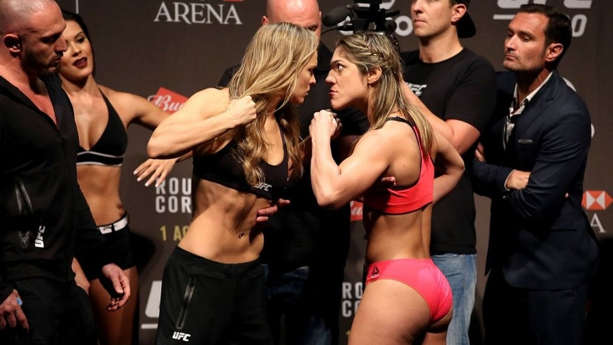 RIO DE JANEIRO, BRAZIL - JULY 31: (L-R) UFC Bantamweight Champion Ronda Rousey of the United States and Bethe Correia of Brazil face off during their UFC 190 weigh-in at HSBC Arena on July 31, 2015 in Rio de Janeiro, Brazil. (Photo by Matthew Stockman/Getty Images)