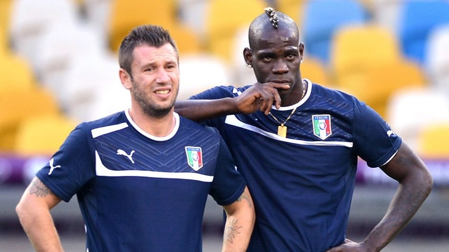 Italians forwards Antonio Cassano (L) and Mario Balotelli take part in a training session on June 30, 2012 at the Olympic Stadium in Kiev, on the eve of the team's Euro 2012 football championships final match. AFP PHOTO / GABRIEL BOUYS (Photo credit should read GABRIEL BOUYS/AFP/GettyImages)