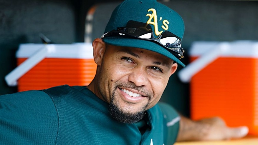 <p>Oct 7, 2013; Detroit, MI, USA; Oakland Athletics center fielder Coco Crisp (4) in the dugout before game three of the American League divisional series playoff baseball game against the Detroit Tigers at Comerica Park. Mandatory Credit: Rick Osentoski-USA TODAY Sports</p>