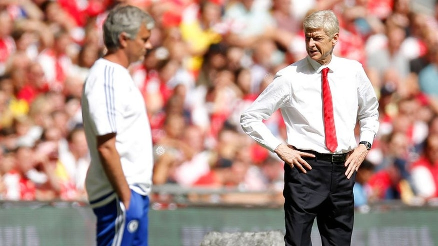 "Football - Chelsea v Arsenal - FA Community Shield - Wembley Stadium - 2/8/15 Arsenal manager Arsene Wenger and Chelsea manager Jose Mourinho (L) Action Images via Reuters / Andrew Couldridge Livepic EDITORIAL USE ONLY. No use with unauthorized audio, video, data, fixture lists, club/league logos or ""live"" services. Online in-match use limited to 45 images, no video emulation. No use in betting, games or single club/league/player publications. Please contact your account representative for further details."