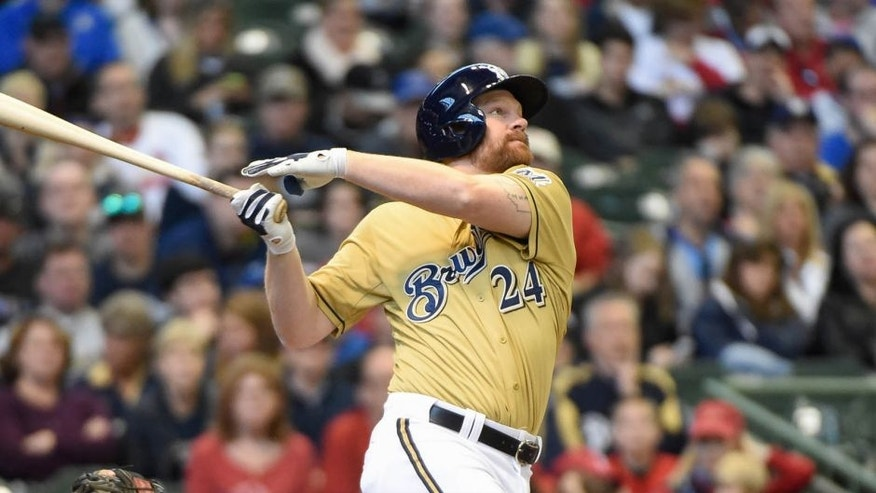 Apr 26, 2015; Milwaukee, WI, USA; Milwaukee Brewers first baseman Adam Lind hits a two-run homer in the third inning against the St. Louis Cardinals at Miller Park.