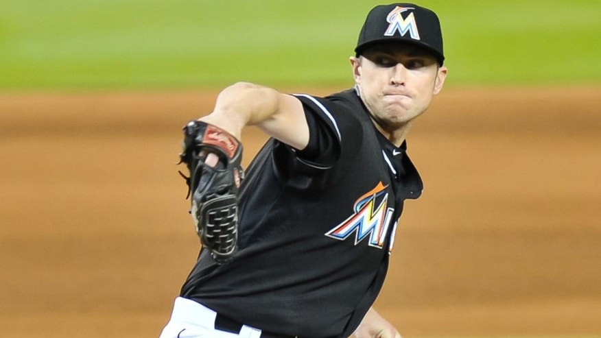 Aug 1, 2015; Miami, FL, USA; Miami Marlins relief pitcher Chris Reed (35) throws against the San Diego Padres during the eighth inning at Marlins Park. Mandatory Credit: Steve Mitchell-USA TODAY Sports