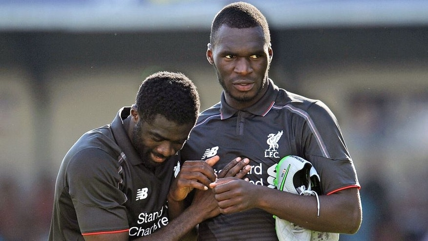 SWINDON, ENGLAND - AUGUST 02: (THE SUN OUT, THE SUN ON SUNDAY OUT) Christian Benteke and Kolo Toure of Liverpool show their appreciation to the fans at the end of a preseason friendly at County Ground on August 2, 2015 in Swindon, England. (Photo by Andrew Powell/Liverpool FC via Getty Images)
