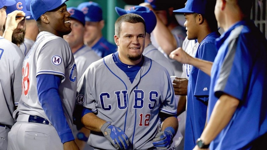 CINCINNATI, OH - JULY 21: Kyle Schwarber #12 of the Chicago Cubs is congratulated by teammates after hitting a game winning home run in the 13th inning against the Cincinnati Reds in the second inning at Great American Ball Park on July 21, 2015 in Cincinnati, Ohio. The Cubs won 5-4. (Photo by Andy Lyons/Getty Images)