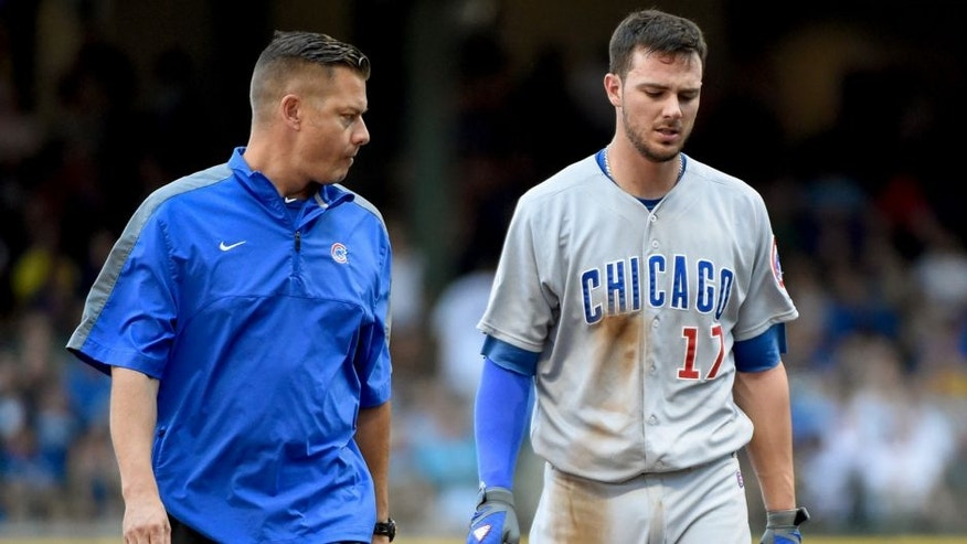 Aug 2, 2015; Milwaukee, WI, USA; Chicago Cubs third baseman Kris Bryant (17) is escorted off the field by a trainer after an injury in the fifth inning during the game against the Milwaukee Brewers at Miller Park. Mandatory Credit: Benny Sieu-USA TODAY Sports