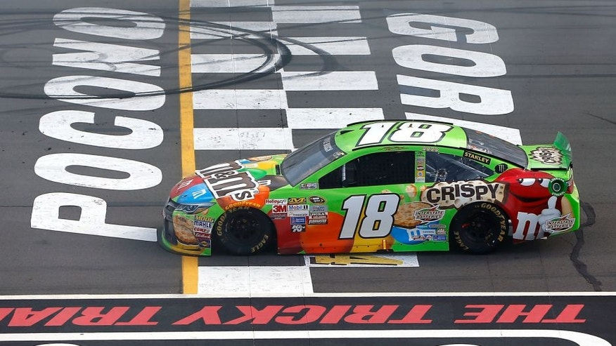 LONG POND, PA - AUGUST 02: Kyle Busch, driver of the #18 M&M's Crispy Toyota, is seen after running out of fuel in the closing laps of the NASCAR Sprint Cup Series Windows 10 400 at Pocono Raceway on August 2, 2015 in Long Pond, Pennsylvania. (Photo by Jonathan Ferrey/NASCAR via Getty Images)