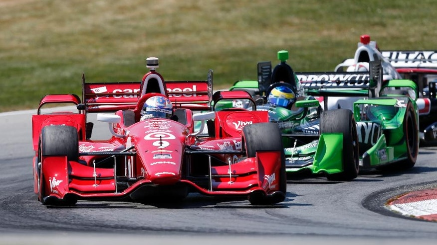 Scott Dixon, of New Zealand, leads Sebastien Bourdais, of France, on the first lap during the IndyCar Honda Indy 200 auto race Sunday, Aug. 2, 2015, at Mid-Ohio Sports Car Course in Lexington, Ohio. (AP Photo/Tom E. Puskar)
