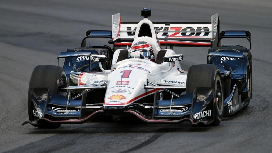 Will Power, of Australia, drives during qualifying for the IndyCar Honda Indy 200 auto race Saturday, Aug. 1, 2015, at Mid-Ohio Sports Car Course in Lexington, Ohio. (AP Photo/Tom E. Puskar)