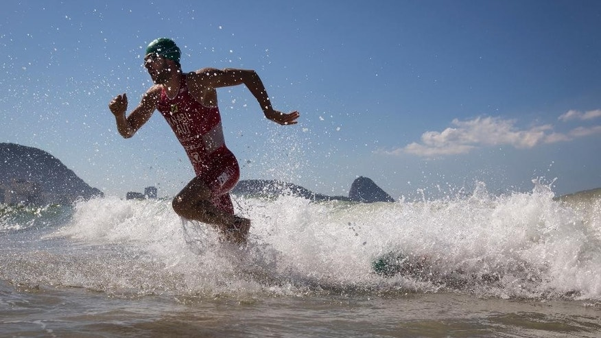 Alois Jnabl of Austria exits the water during the men's triathlon ITU World Olympic Qualification Event in Rio de Janeiro, Brazil, Sunday, Aug. 2, 2015. The World Olympic Qualification is a test event for the Rio 2016 Olympics. (AP Photo/Felipe Dana)