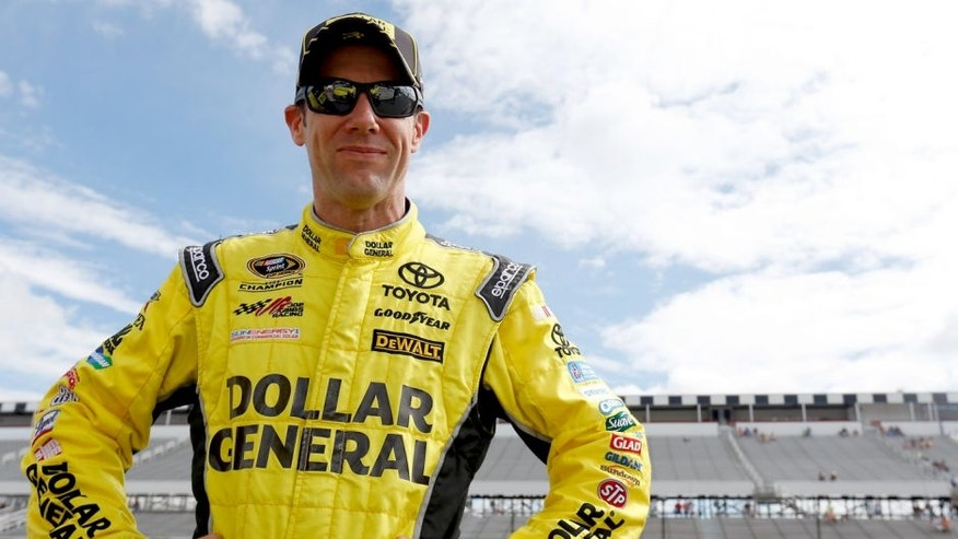 """LONG POND, PA - JUNE 05: Matt Kenseth, driver of the #20 Dollar General Toyota, stands on the grid during qualifying for the NASCAR Sprint Cup Series Axalta """"We Paint Winners"""" 400 at Pocono Raceway on June 5, 2015 in Long Pond, Pennsylvania. (Photo by Todd Warshaw/NASCAR via Getty Images)"""