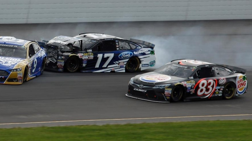 Sam Hornish Jr. (9) and Ricky Stenhouse Jr. (17) collide in Turn 1 as Matt DiBenedetto (83) drives past during the NASCAR Pocono 400 auto race, Sunday, Aug. 2, 2015, in Long Pond, Pa. (AP Photo/Matt Slocum)