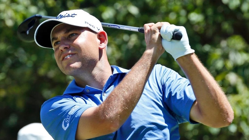 Bill Haas watches his tee shot on the second hole during the final round of the Quicken Loans National golf tournament at the Robert Trent Jones Golf Club in Gainesville, Va., Sunday, Aug. 2, 2015. (AP Photo/Steve Helber)
