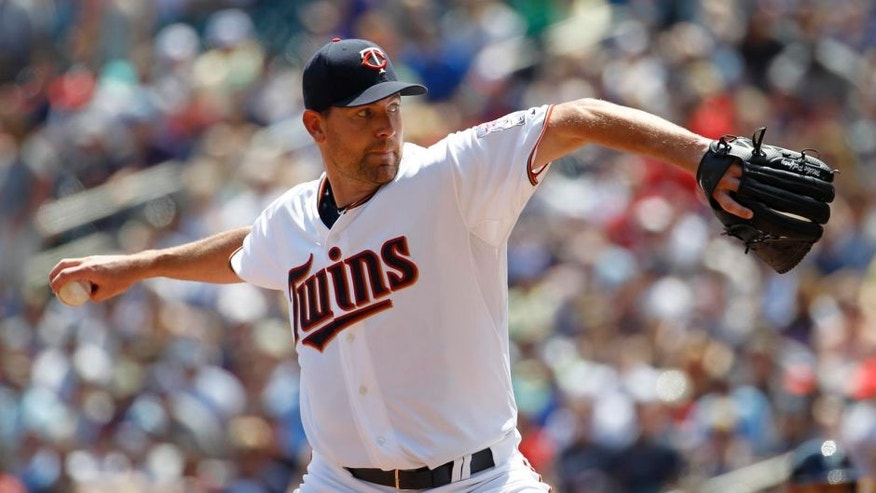 Minnesota Twins starting pitcher Mike Pelfrey delivers to the Milwaukee Brewers during the first inning in Minneapolis, Sunday, June 7, 2015.