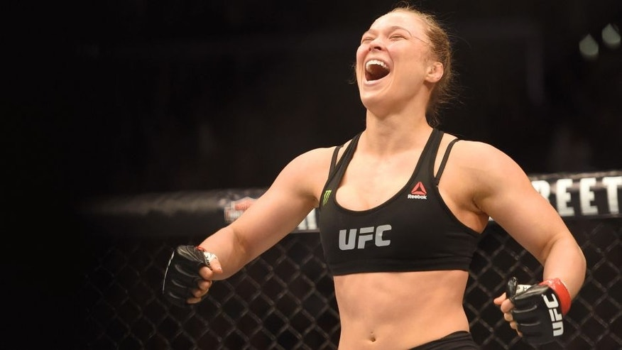 Ronda Rousey celebrates her victory over Cat Zingano in their UFC women's bantamweight championship bout during the UFC 184 event at Staples Center on February 28, 2015 in Los Angeles, California. (Photo by Harry How/Getty Images)