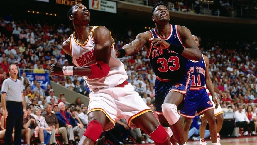 <p>HOUSTON - JUNE 19: Hakeem Olajuwon #34 of the Houston Rockets battles for position against Patrick Ewing #33 of the New York Knicks during Game Six of the NBA Finals played on June 19, 1994 at the The Summit in Houston, Texas. NOTE TO USER: User expressly acknowledges that, by downloading and or using this photograph, User is consenting to the terms and conditions of the Getty Images License agreement. Mandatory Copyright Notice: Copyright 1994 NBAE (Photo by Nathaniel S. Butler/NBAE via Getty Images)</p>