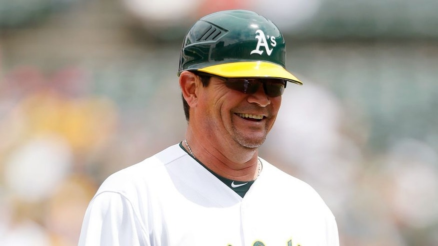 <p>OAKLAND, CA - JULY 1: Third Base Coach Mike Gallego #2 of the Oakland Athletics stands on the field during the game against the Colorado Rockies at O.co Coliseum on July 1, 2015 in Oakland, California. The Athletics defeated the Rockies 4-1. (Photo by Michael Zagaris/Oakland Athletics/Getty Images)</p>