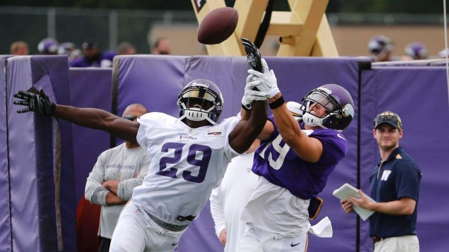 Minnesota Vikings cornerback Xavier Rhodes (left) breaks up a pass intended for wide receiver Adam Thielen during the first practice in full pads at training camp on the campus of Minnesota State University in Mankato on Tuesday, July 28, 2015.