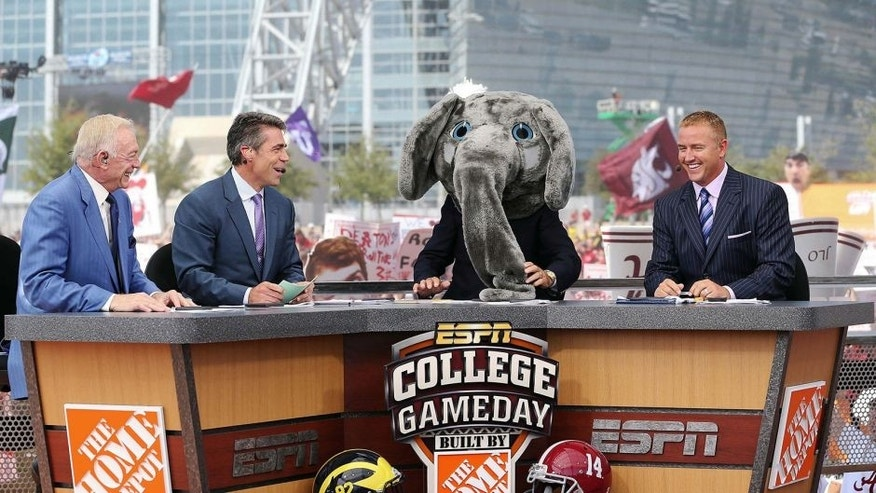 Sep 1, 2012; Arlington, TX, USA; Dallas Cowboys owner Jerry Jones (far left) on the set of ESPN College Gameday with Chris Fowler (second to left) and Lee Corso (in elephant costume) and Kirk Herbstreit (far right) before the game between the Alabama Crimson Tide and the Michigan Wolverines at Cowboys Stadium. Mandatory Credit: Kevin Jairaj-USA TODAY Sports
