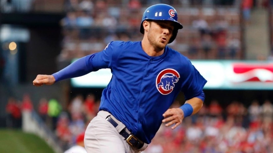 Chicago Cubs' Kris Bryant rounds third and heads in to score on a single by Starlin Castro during the first inning of a baseball game against the St. Louis Cardinals, Monday, May 4, 2015, in St. Louis. (AP Photo/Jeff Roberson)