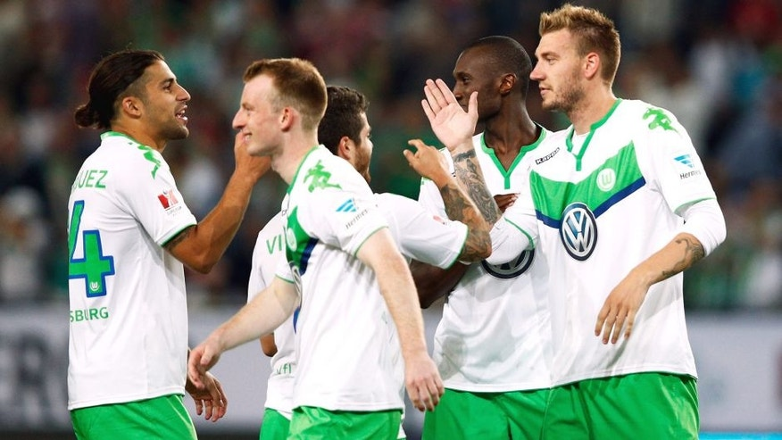 WOLFSBURG, GERMANY - AUGUST 01: Nicklas Bendtner of VfL Wolfsburg is congratulated by team mates after he scores the winning penalty in the shoot out during the DFL Supercup match between VfL Wolfsburg and FC Bayern Muenchen at Volkswagen Arena on August 1, 2015 in Wolfsburg, Germany. (Photo by Dean Mouhtaropoulos/Bongarts/Getty Images)