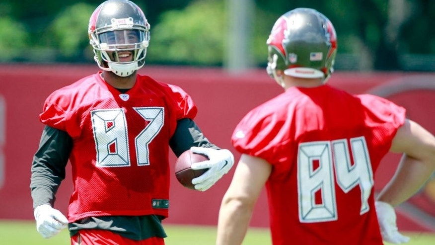May 28, 2015; Tampa, FL, USA; Tampa Bay Buccaneers tight end Austin Seferian-Jenkins (87) and tight end Cameron Brate (84) smile as they work out at One Buc Place. Mandatory Credit: Kim Klement-USA TODAY Sports